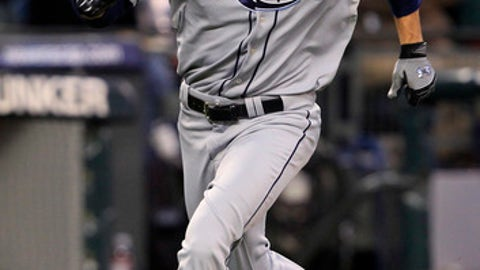 Tampa Bay Rays' Gabe Kapler races home to score against the Seattle Mariners in the fifth inning during a baseball game Wednesday, May 5, 2010, in Seattle. Kapler doubled in a run on a single earlier in the inning. (AP Photo/Elaine Thompson)