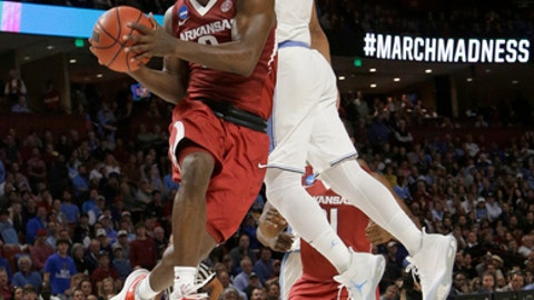 FILE - In this March 19, 2017, file photo, Arkansas' Jaylen Barford, left, drives past North Carolina's Joel Berry II, right, during the second half in a second-round game of the NCAA men's college basketball tournament in Greenville, S.C. Arkansas coach Mike Anderson is ready to do more than just make the postseason. He's ready to return the Razorbacks to prominence in the SEC after two NCAA Tournament appearances in the last three years, and he might just have the team to do it this year, led by senior guards Barford and Daryl Macon. (AP Photo/Chuck Burton, File)