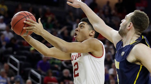 FILE - In this March 9, 2017, file photo, Utah's Sedrick Barefield shoots around California's Kameron Rooks during the first half of an NCAA college basketball game in the quarterfinals of the Pac-12 men's tournament in Las Vegas. Barefield can throw up points in bunches, but when to do so will be the key for the Utah guard. And the Utes will need him to make the right decision on a regular basis after losing four starters from the 2016-17 team. (AP Photo/John Locher, File)