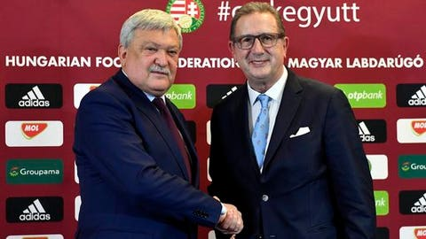 New head coach of the Hungarian national soccer team Georges Leekens of Belgium, right, and President of the Hungarian Soccer Federation (MLSZ) Sandor Csanyi shake hands prior to Leekens' press conference in the training centre in Telki, 19 kms west of Budapest, Hungary, Monday, Oct. 30, 2017. (Tibor Illyes/MTI via AP)