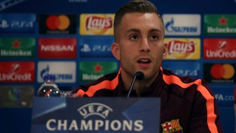 Barcelona's Gerard Deulofeu speaks during news conference at Georgios Karaiskakis stadium at Piraeus port, near Athens, on Monday, Oct. 30, 2017. Barcelona will play against Olympiakos for the Champions League group D soccer match on Tuesday. (AP Photo/Petros Giannakouris)