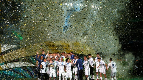 FILE - In this Sunday, Dec. 18, 2016 file photo, Real Madrid players celebrate on the podium after defeating Kashima Antlers in the final of the FIFA Club World Cup soccer tournament in Yokohama, near Tokyo. A member of FIFA's ruling council says there are proposals for a 24-team Club World Cup to be played every four years from 2021, it was reported on Monday, Oct. 30, 2017. (AP Photo/Shuji Kajiyama, File)