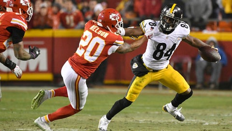 Kansas City Chiefs cornerback Steven Nelson (20) attempts to tackle Pittsburgh Steelers wide receiver Antonio Brown (84) during the first half of an NFL divisional playoff football game Sunday, Jan. 15, 2017, in Kansas City, Mo. (AP Photo/Ed Zurga)