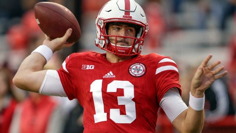 FILE - This Oct. 14, 2017 file photo shows Nebraska quarterback Tanner Lee (13) warming up before an NCAA college football game against Ohio State in Lincoln, Neb. Lee threw for a career-high 431 yards in Nebraska's 25-24 win over Purdue on Saturday in West Lafayette, Indiana. The 431 yards tied Zac Taylor for the fourth-most in program history. On the game-winning 70-yard touchdown drive, Lee completed 7 of 8 passes for 70 yards, including the go-ahead 13-yard TD pass to Stanley Morgan Jr. (AP Photo/Nati Harnik)