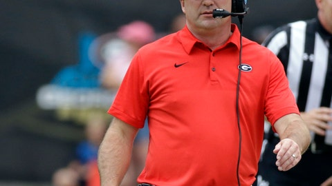 This Oct. 28, 2017 photo shows Georgia head coach Kirby Smart walking the sideline in the first half of an NCAA college football game against Florida in Jacksonville, Fla. A lopsided win over Florida pushed Georgia up another spot in the AP Top 25 to No. 2. It also moved the Bulldogs closer to the SEC championship game heading into Saturday's home game against South Carolina _ a matchup of the top two teams in the SEC East. (AP Photo/John Raoux)