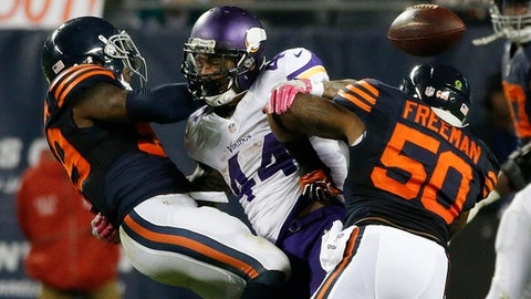 Chicago Bears inside linebackers Danny Trevathan, left, and Jerrell Freeman (50) defend Minnesota Vikings running back Matt Asiata (44) on a pass attempt during the second half of an NFL football game in Chicago, Monday, Oct. 31, 2016. (AP Photo/Nam Y. Huh)