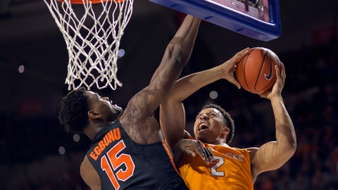 FILE -- In this Jan. 7, 2017 file photo, Florida center John Egbunu (15) fouls Tennessee forward Grant Williams (2) in an NCAA college basketball game in Gainesville, Fla. For the second straight year, the Southeastern Conference's preseason media poll projected Tennessee to finish 13th out of 14 conference teams. The Vols realize the doubts about their team will linger as long as they keep missing the NCAA Tournament. (AP Photo/Ron Irby)