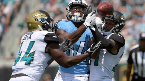 FILE - In this Sunday, Sept. 17, 2017 file photo, Jacksonville Jaguars outside linebacker Myles Jack (44) and cornerback A.J. Bouye, right, break up a pass intended for Tennessee Titans wide receiver Corey Davis during the first half of an NFL football game, Sunday, Sept. 17, 2017, in Jacksonville, Fla. Tennessee Titans finally might see rookie Corey Davis in a game again after the No. 5 pick overall missed the last five games. Davis practiced Monday, Oct. 30, 2017, even though he was limited, and says he's feeling good. (AP Photo/Phelan M. Ebenhack, File)