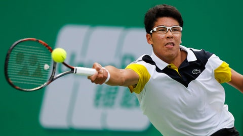 Chung Hyeon of South Korea hits a return shot against Roberto Bautista Agut of Spain during their men's singles match of the Shanghai Masters tennis tournament at Qizhong Forest Sports City Tennis Center in Shanghai, China, Monday, Oct. 9, 2017. (AP Photo/Andy Wong)