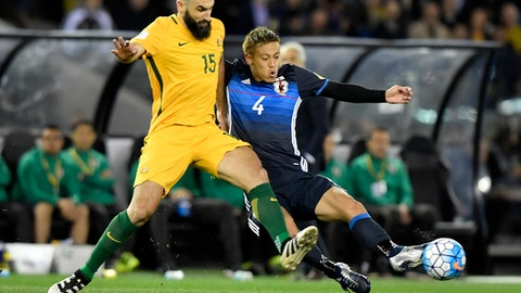 FILE - In this Oct. 11, 2016 file photo, Australia's Mile Jedinak, left, and Japan's Keisuke Honda contest for the ball during their World Cup qualifying match in Melbourne, Australia. Skipper Mile Jedinak has been recalled to Australia's squad for the first time since June to prepare for next month's World Cup intercontinental playoff against Honduras. (AP Photo/Andy Brownbill, File)
