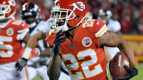 Kansas City Chiefs defensive back Marcus Peters (22) carries ball he stripped from Denver Broncos running back Jamaal Charles, during the first half of an NFL football game in Kansas City, Mo., Monday, Oct. 30, 2017. Peters recovered the ball and ran for a touchdown. (AP Photo/Ed Zurga)