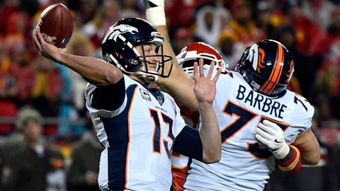 Denver Broncos quarterback Trevor Siemian (13) throws a ball which was intercepted by Kansas City Chiefs defensive back Marcus Peters during the first half of an NFL football game in Kansas City, Mo., Monday, Oct. 30, 2017. (AP Photo/Ed Zurga)