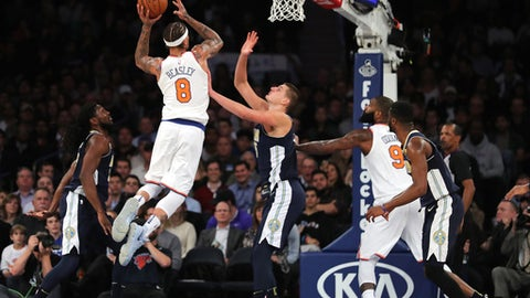 NEW YORK, NY - OCTOBER 30:  Michael Beasley #8 of the New York Knicks takes a shot against Nikola Jokic #15 of the Denver Nuggets in the second half during their game at Madison Square Garden on October 30, 2017 in New York City. NOTE TO USER: User expressly acknowledges and agrees that, by downloading and or using this photograph, User is consenting to the terms and conditions of the Getty Images License Agreement.  (Photo by Abbie Parr/Getty Images)