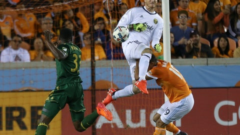 Portland Timbers goalkeeper Jeff Attinella (1) collides with Houston Dynamo forward Mauro Manotas (19) as he comes out to get the ball away from Manotas during the MLS Western Conference semifinal soccer match Monday, Oct. 30, 2017, in Houston. (Yi-Chin Lee/Houston Chronicle via AP)