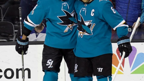 San Jose Sharks' Joe Pavelski, right, celebrates his goal with teammate Brenden Dillon during the second period of an NHL hockey game against the Toronto Maple Leafs Monday, Oct. 30, 2017, in San Jose, Calif. (AP Photo/Marcio Jose Sanchez)