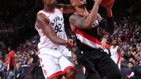 PORTLAND, OR - OCTOBER 30:  Damian Lillard #0 of the Portland Trail Blazers goes for a lay up against Lucas Nogueira #92 of the Toronto Raptors on October 30, 2017 at the Moda Center in Portland, Oregon. NOTE TO USER: User expressly acknowledges and agrees that, by downloading and or using this Photograph, user is consenting to the terms and conditions of the Getty Images License Agreement. Mandatory Copyright Notice: Copyright 2017 NBAE (Photo by Sam Forencich/NBAE via Getty Images)