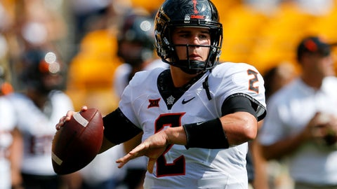 FILE - In this Sept. 16, 2017, file photo, Oklahoma State quarterback Mason Rudolph (2) during warmups before an NCAA football game against Pittsburgh in Pittsburgh. Rudolph of No. 11 Oklahoma State sometimes gets lost in the chatter about the nation's best quarterbacks. He leads the FBS in yards passing per game and ranks third in yards per attempt. He also leads the nation in completions of at least 30 yards. He and the rest of the Cowboys host No. 8 Oklahoma this Saturday, Nov. 4. (AP Photo/Keith Srakocic, File)
