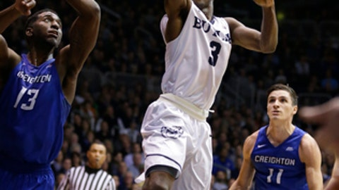 FILE - In this Jan. 31, 2017 file photo, Butler guard Kamar Baldwin (3) shoots over Creighton forward Cole Huff (13) in the first half of an NCAA college basketball game in Indianapolis. (AP Photo/Michael Conroy, File)