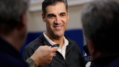 FILE - In this March 20, 2017, file photo, Villanova's Jay Wright smiles while listening to a question during a media availability at the NCAA college basketball team's practice facility, in Villanova, Pa. Wright had a couple of planners in his office and blueprints on the big screen that brought to life some of the striking renovations underway across the street at Villanova's on-campus arena. Wright gives his input when needed, but Nova's coach mostly leaves the redecorating to the pros. (AP Photo/Matt Slocum, File)