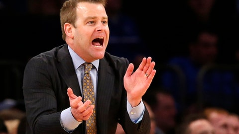FILE - In this March 9, 2017, file photo, Marquette head coach Steve Wojciechowski encourages his team during the second half an NCAA college basketball game against Seton Hall in the quarterfinals of the Big East Conference tournament at Madison Square Garden in New York.  Marquette's first trip to the NCAAs in Wojciechowski's tenure offered more proof that the program is headed in the right direction. (AP Photo/Kathy Willens, File)