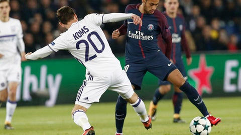 Anderlecht's Sven Kums, left, and PSG's Neymar battle for the ball during a Champions League Group B soccer match between Paris Saint-Germain and Anderlecht at Parc des Princes stadium in Paris, France, Tuesday, Oct. 31, 2017. (AP Photo/Thibault Camus)