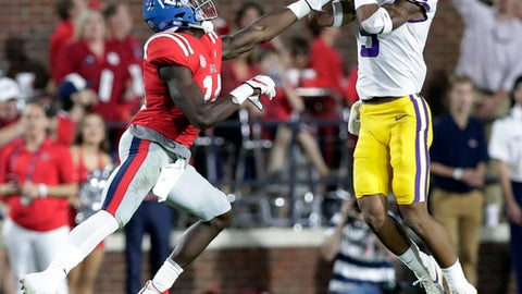 FILE - In this Oct. 21, 2017, file photo, LSU safety Grant Delpit (9) intercepts a pass intended for Mississippi wide receiver D.K. Metcalf (14) in the first half of an NCAA college football game in Oxford, Miss. No. 19 LSU has had to rely on numerous young players this season, and their inexperience was exposed during an inconsistent start to the season. The Tigers have progressed recently, winning three straight, but it remains to be seen whether LSU's youth is prepared to hold its own during trip to No. 1 Alabama this weekend. (AP Photo/Rogelio V. Solis, File)