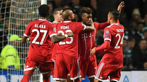 Bayern Munich Kingsley Coman, second right, celebrates scoring during the Champions League group B match between Celtic FC and FC Bayern Munich at Celtic Park, Glasgow, Tuesday Oct. 31, 2017. (AP Photo)