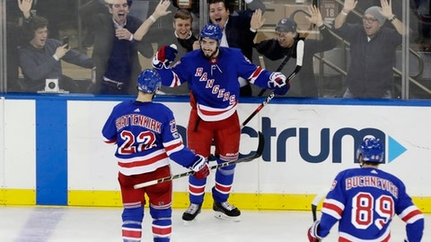 New York Rangers' Mika Zibanejad (93) celebrates with teammate Kevin Shattenkirk (22) and Pavel Buchnevich (89) after scoring a goal during the third period of an NHL hockey game against the Vegas Golden Knights Tuesday, Oct. 31, 2017, in New York. The Rangers won 6-4. (AP Photo/Frank Franklin II)