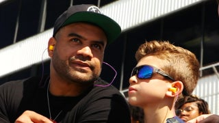 Shawne Merriman launches 'Lights Out Drive' youth initiative, takes 100 students to a race at Dover International Speedway
