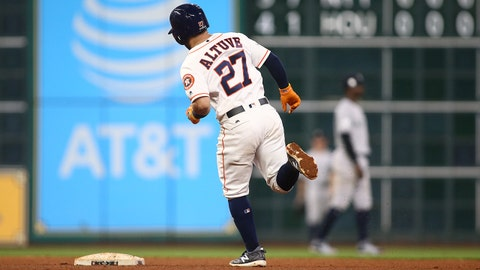 Oct 20, 2017; Houston, TX, USA; Houston Astros second baseman Jose Altuve (27) runs the bases after hitting a solo home run against the New York Yankees in the eighth inning during game six of the 2017 ALCS playoff baseball series at Minute Maid Park. Mandatory Credit: Troy Taormina-USA TODAY Sports