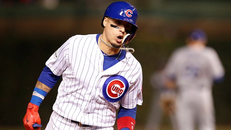 Javier Baez hits 2 solo shots off Alex Wood as Chicago fends off LA in Game 4
