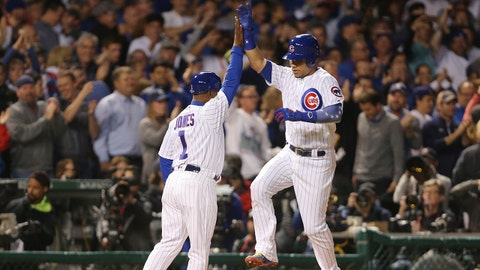 Oct 18, 2017; Chicago, IL, USA; Chicago Cubs catcher Willson Contreras (right) celebrates with third base coach Gary Jones (1) after hitting a solo home run against the Los Angeles Dodgers in the second inning in game four of the 2017 NLCS playoff baseball series at Wrigley Field. Mandatory Credit: Dennis Wierzbicki-USA TODAY Sports