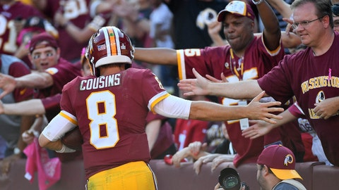 Oct 15, 2017; Landover, MD, USA; Washington Redskins quarterback Kirk Cousins (8) high fives fans after scoring a touchdown against the San Francisco 49ers during the second half at FedEx Field. Mandatory Credit: Brad Mills-USA TODAY Sports