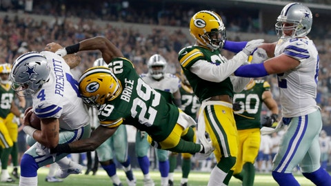 Oct 8, 2017; Arlington, TX, USA; Dallas Cowboys quarterback Dak Prescott (4) scores a touchdown against Green Bay Packers safety Kentrell Brice (29) in the fourth quarter at AT&T Stadium. Mandatory Credit: Tim Heitman-USA TODAY Sports