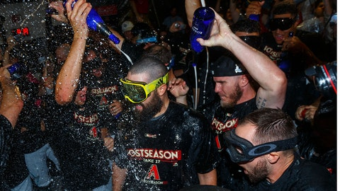 Oct 4, 2017; Phoenix, AZ, USA; Arizona Diamondbacks pitcher Robbie Ray (center) celebrates with teammates in the locker room after defeating the Colorado Rockies in the 2017 National League wildcard playoff baseball game at Chase Field. Mandatory Credit: Mark J. Rebilas-USA TODAY Sports
