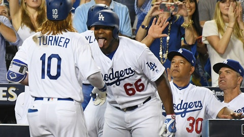 Oct 24, 2017; Los Angeles, CA, USA; Los Angeles Dodgers third baseman Justin Turner (10) celebrates after hitting a two run home run with right fielder Yasiel Puig (66) in the sixth inning against the Houston Astros in game one of the 2017 World Series at Dodger Stadium. Mandatory Credit: Richard Mackson-USA TODAY Sports