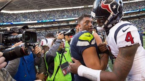 Oct 29, 2017; Seattle, WA, USA; Seattle Seahawks quarterback Russell Wilson (3) embraces Houston Texans quarterback Deshaun Watson (4) after a game at CenturyLink Field. The Seahawks won 41-38. Mandatory Credit: Troy Wayrynen-USA TODAY Sports