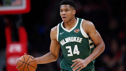 Oct 6, 2017; Chicago, IL, USA; Milwaukee Bucks forward Giannis Antetokounmpo (34) brings the ball up court against the Chicago Bulls during the first half of an NBA preseason game at United Center. Mandatory Credit: Kamil Krzaczynski-USA TODAY Sports