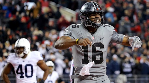 Oct 28, 2017; Columbus, OH, USA; Ohio State Buckeyes quarterback J.T. Barrett (16) reacts to throwing the go ahead touchdown pass against the Penn State Nittany Lions in the second half at Ohio Stadium. Mandatory Credit: Aaron Doster-USA TODAY Sports