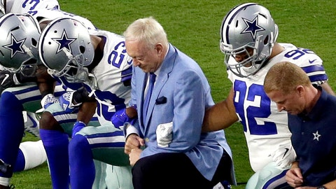 """FILE - In this Monday, Sept. 25, 2017, file photo, the Dallas Cowboys, led by owner Jerry Jones, center, take a knee prior to the national anthem and an NFL football game against the Arizona Cardinals, in Glendale, Ariz. ESPN anchor Jemele Hill has been suspended by the network for two weeks for making political statements on social media.  Hill, who is African-American, received criticism from the network last month after referring to President Donald Trump as a """"white supremacist.""""  On Monday, Oct. 9, 2017, Hill targeted Jerry Jones, after the Dallas Cowboys owner stated that players who disrespect the flag would not play for his team.  (AP Photo/Matt York, File)"""