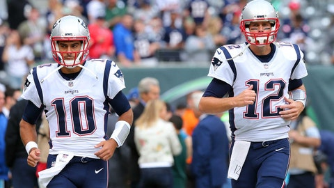Oct 15, 2017; East Rutherford, NJ, USA; New England Patriots quarterback Jimmy Garoppolo (10) and New England Patriots quarterback Tom Brady (12) take the field for warmups before a game against the New York Jets at MetLife Stadium. Mandatory Credit: Brad Penner-USA TODAY Sports