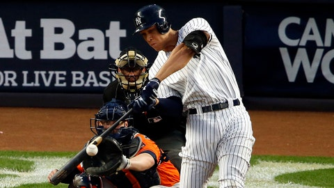 Oct 18, 2017; Bronx, NY, USA; New York Yankees right fielder Aaron Judge (99) hits an RBI double during the third inning against the Houston Astros in game five of the 2017 ALCS playoff baseball series at Yankee Stadium. Mandatory Credit: Adam Hunger-USA TODAY Sports