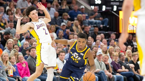 Oct 28, 2017; Salt Lake City, UT, USA; Utah Jazz guard Donovan Mitchell (45) dribbles the ball past Los Angeles Lakers guard Lonzo Ball (2) during the second half at Vivint Smart Home Arena. Mandatory Credit: Russ Isabella-USA TODAY Sports