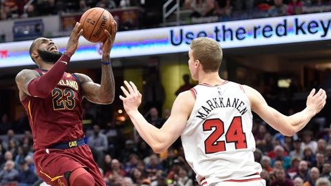 Oct 24, 2017; Cleveland, OH, USA; Cleveland Cavaliers forward LeBron James (23) drives between Chicago Bulls guard Paul Zipser (16) and forward Lauri Markkanen (24) in the fourth quarter at Quicken Loans Arena. Mandatory Credit: David Richard-USA TODAY Sports