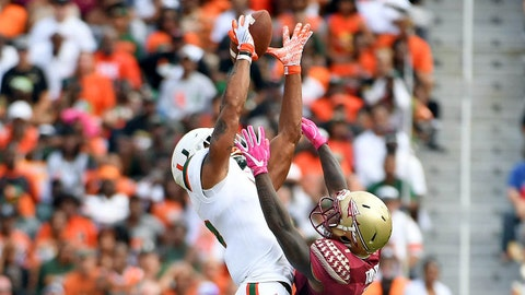 Oct 7, 2017; Tallahassee, FL, USA; Miami Hurricanes wide receiver Lawrence Cager (18) has the ball knocked away by Florida State University defensive back Levonta Taylor (1) during the first half at Doak Campbell Stadium. Mandatory Credit: Melina Vastola-USA TODAY Sports