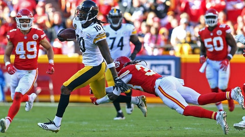 Oct 15, 2017; Kansas City, MO, USA; Pittsburgh Steelers wide receiver Martavis Bryant (10) is tackled by Kansas City Chiefs free safety Ron Parker (38) in the first half at Arrowhead Stadium. Mandatory Credit: Jay Biggerstaff-USA TODAY Sports