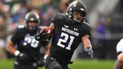 Oct 28, 2017; Evanston, IL, USA; Northwestern Wildcats running back Justin Jackson (21) avoids a tackle by Michigan State Spartans line backer Joe Bachie (35) during the first half at Ryan Field. Mandatory Credit: Patrick Gorski-USA TODAY Sports