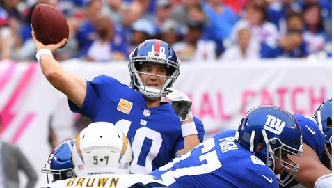 Oct 8, 2017; East Rutherford, NJ, USA; New York Giants quarterback Eli Manning (10) throwing in the second half over the Chargers at MetLife Stadium. Mandatory Credit: Robert Deutsch-USA TODAY Sports