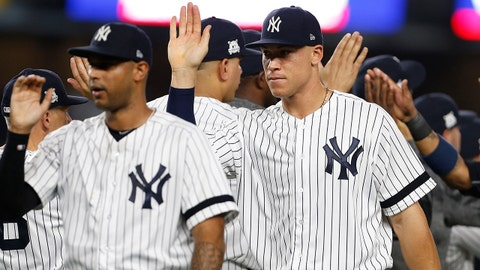 October 9, 2017; Bronx, NY, USA; New York Yankees right fielder Aaron Judge (99) celebrates the victory against the Cleveland Indians following game four of the 2017 ALDS playoff baseball series at Yankee Stadium. Mandatory Credit: Adam Hunger-USA TODAY Sports