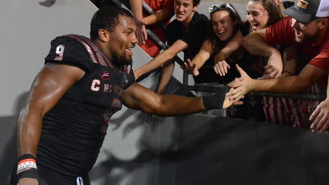 Oct 5, 2017; Raleigh, NC, USA; North Carolina State Wolfpack defensive end Bradley Chubb (9) greets fans after a win against the Louisville Cardinals at Carter-Finley Stadium. The Wolfpack won 39-25.  Mandatory Credit: Rob Kinnan-USA TODAY Sports